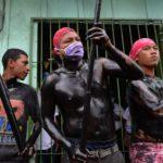 Imágenes | Procesión de «Minguito» entre «diablos negros» y mascarillas en tiempos del Covid-19