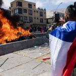 Chile: la marcha contra migrantes que terminó con la quema de pertenencias y carpas de extranjeros