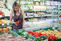 A woman shopping vegetables