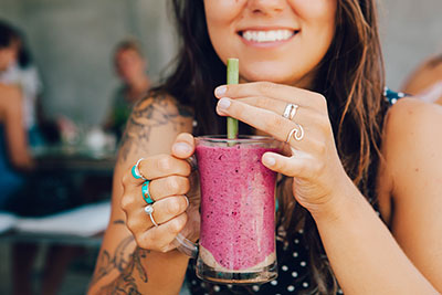 Young girl having a healthy smoothie drink