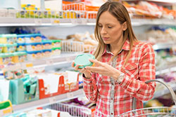 Young woman reading nutrition label