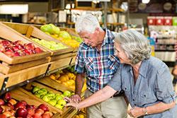 Senior couple buying apples