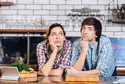 Young couple thinking on the kitchen
