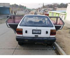 Venta de carro Nissan march 1990