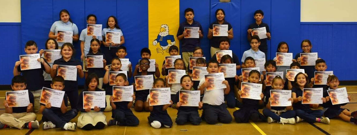 Group of five school boys enjoying some popsicles outside