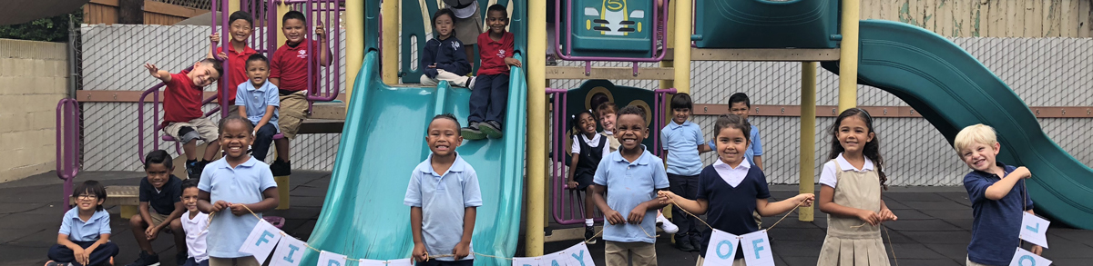 Students posing on a playground