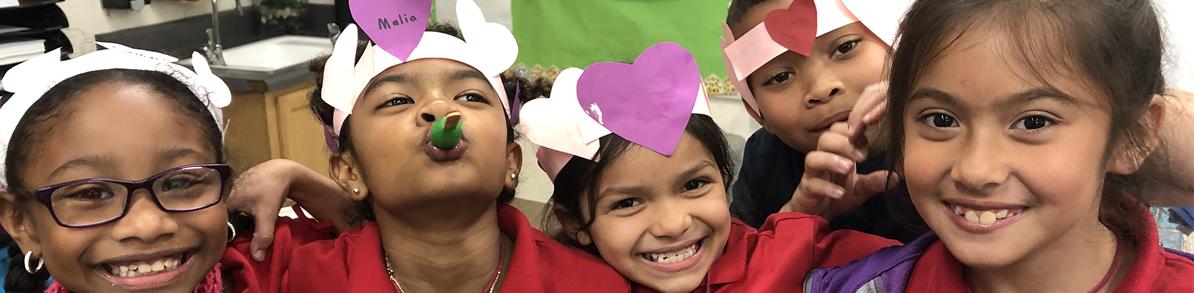 Oakwood Academy students wearing paper heart hats