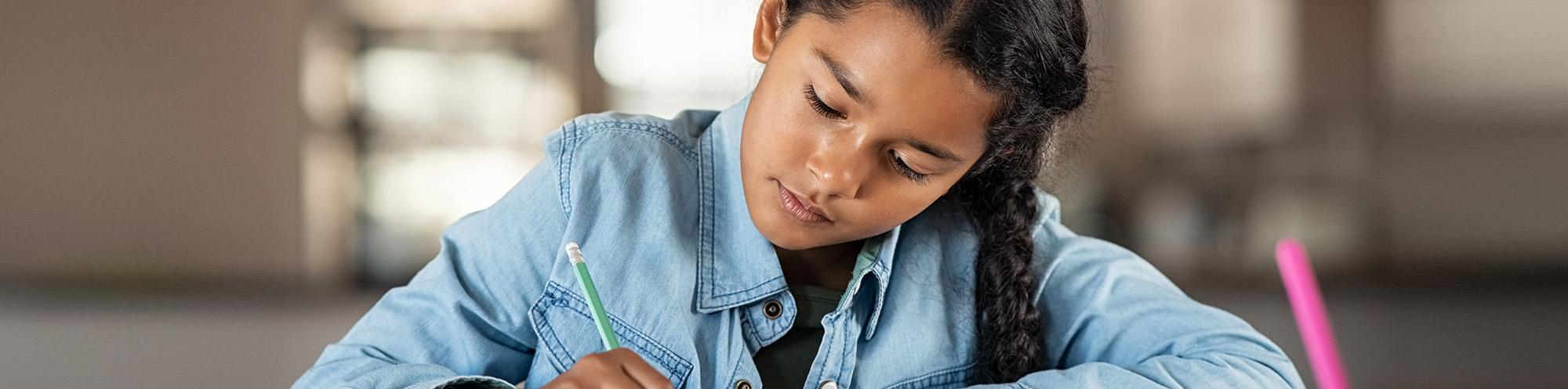 Studious girl doing homework