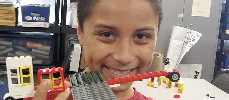 student with lego model