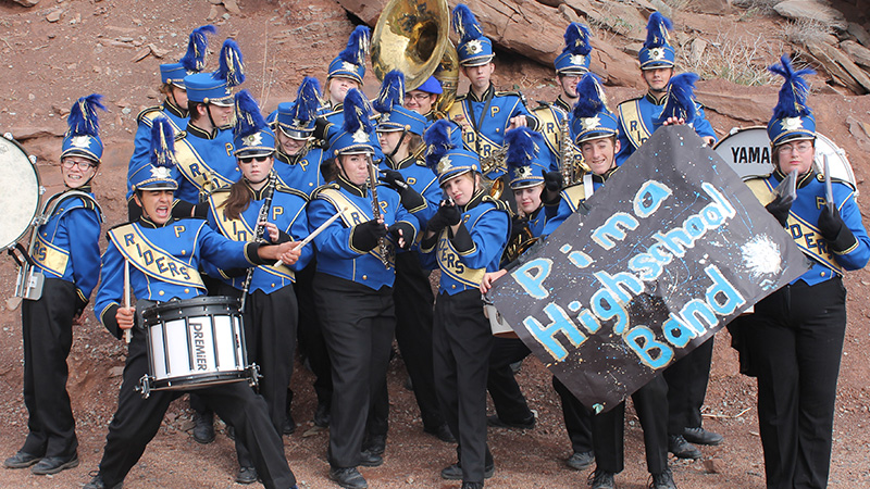 Marching band posing together outside