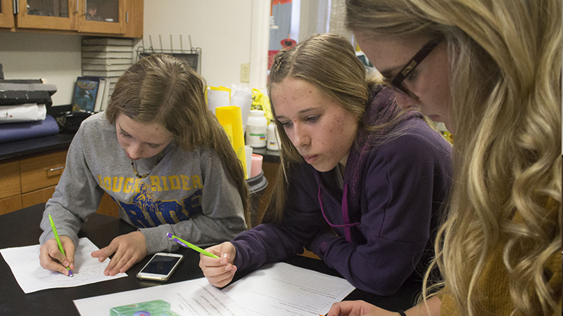 Three students working together