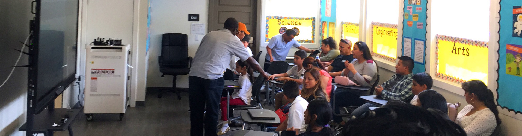 parents and students in a classroom