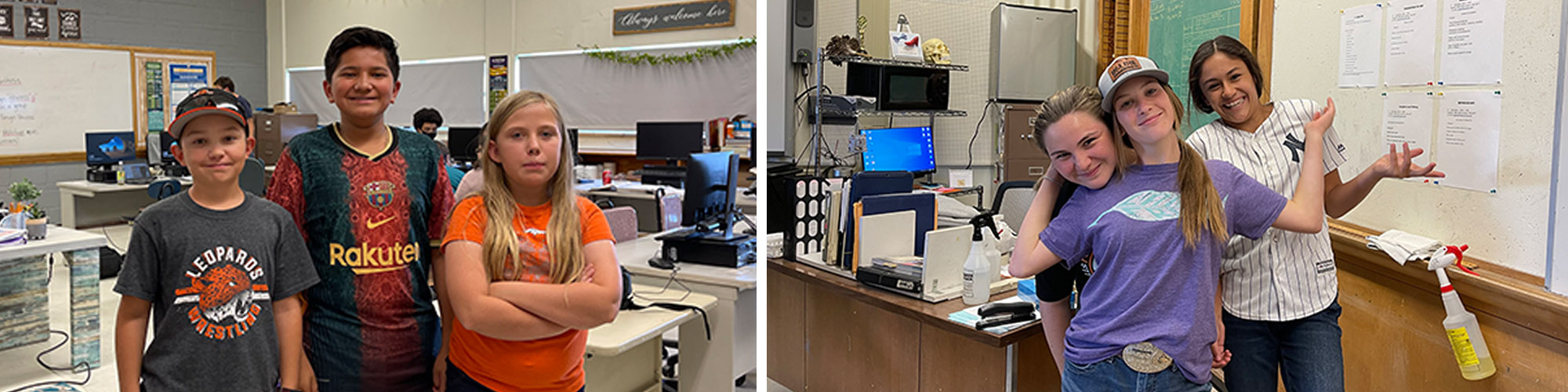 Group of elementary children standing in front of a yellow school bus