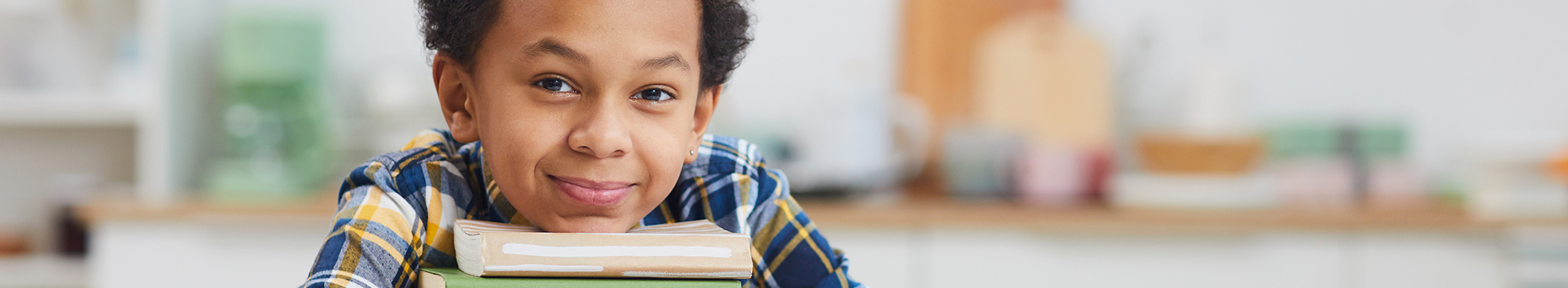Close up of student sitting at a desk with books