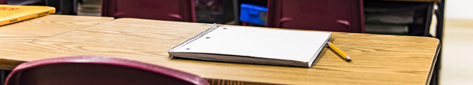 closeup of notebook sitting on a desk