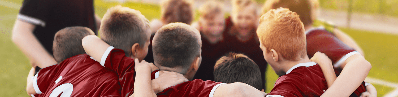 boys soccer team huddle