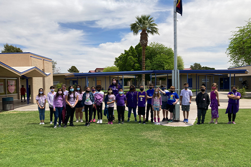 Class of students wearing purple