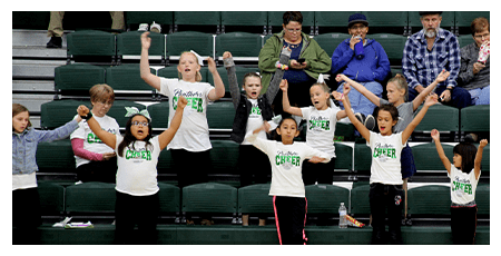 Elementary students cheering together