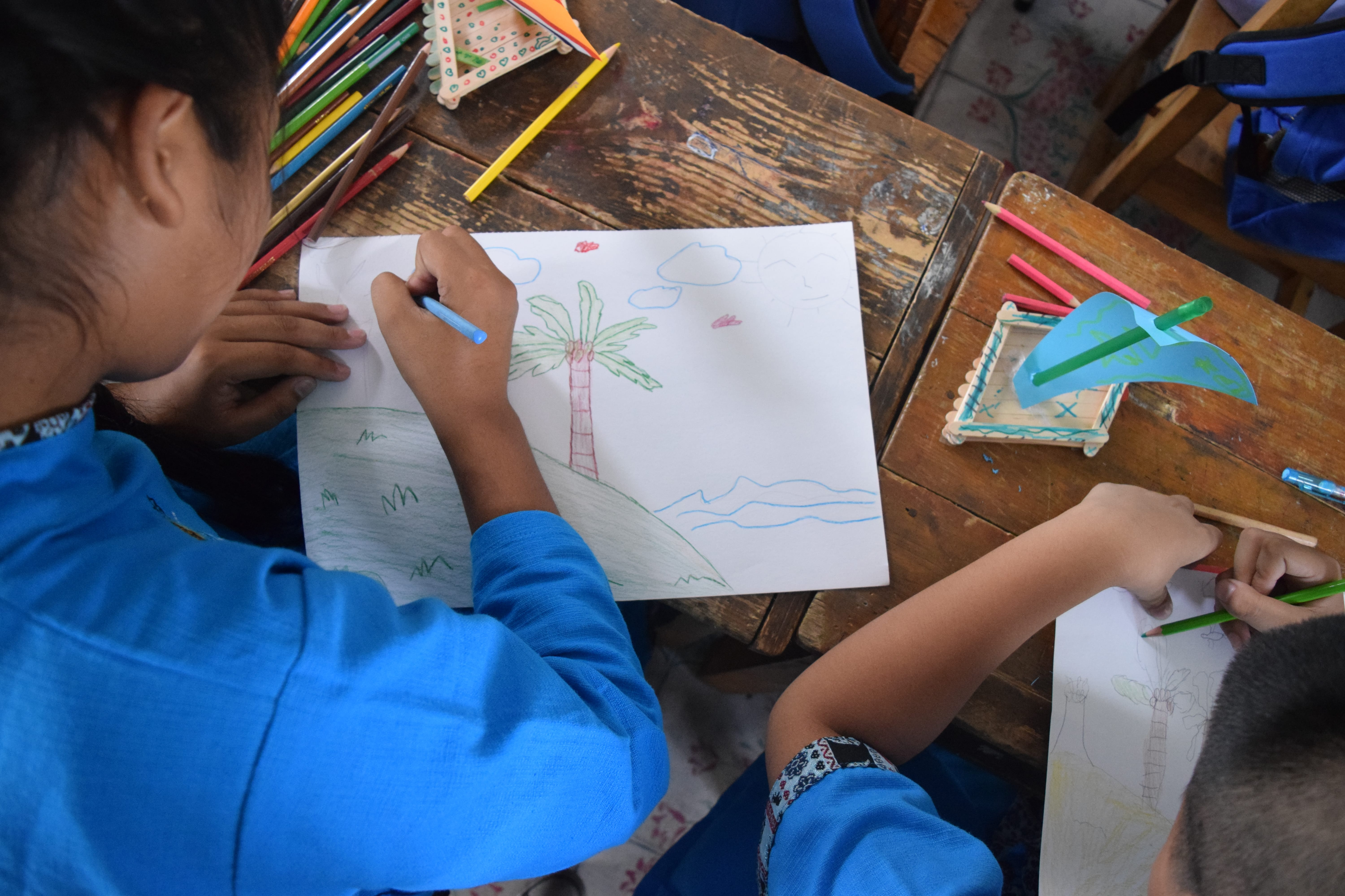 Wat Pa Pao students worked hard on their island drawings!