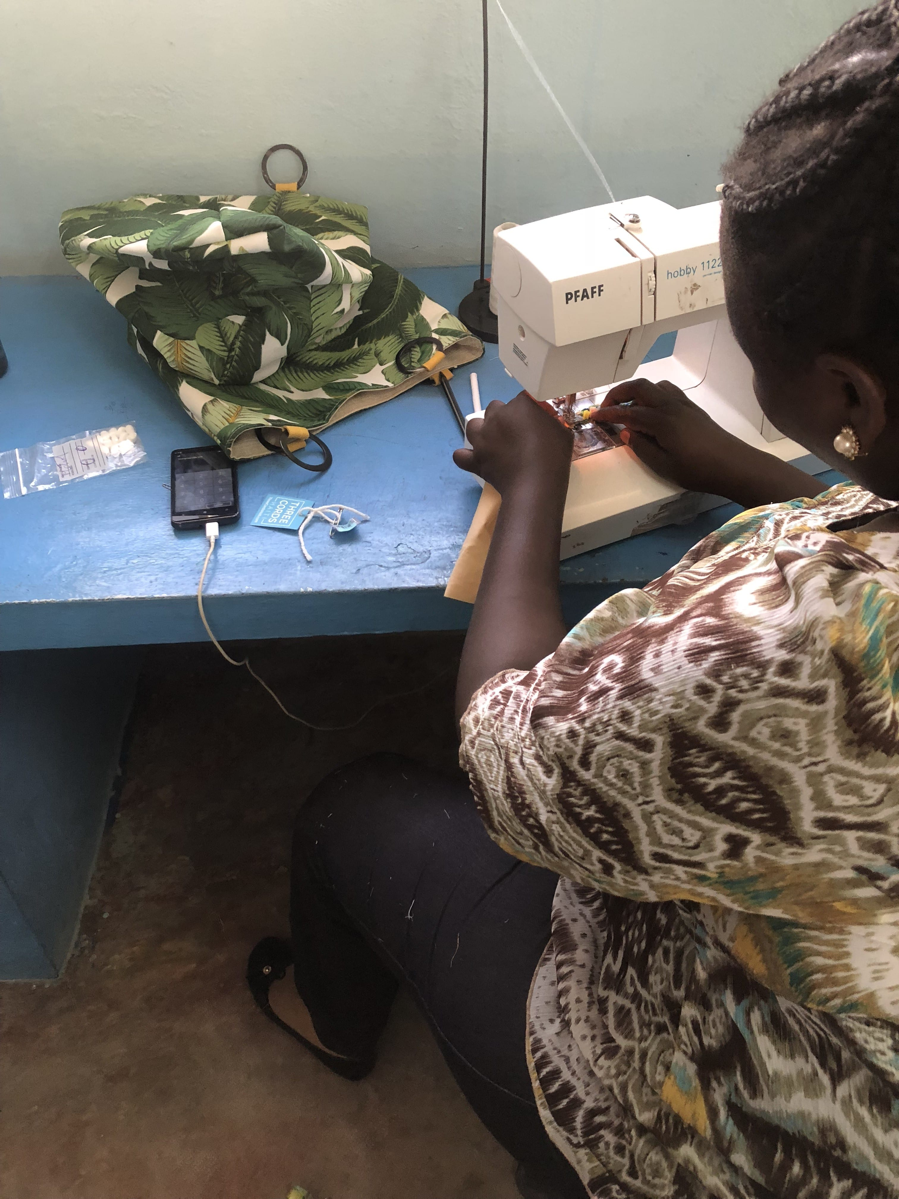 A seamstress creating a beautiful clutch