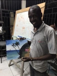 Jimson holding the painting he so patiently helped me with. Can you tell which palm tree is mine? Haha