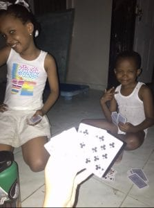 Playing casino, a Haitian card game, with the neighbor kids!