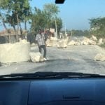 A road block charging money to pass