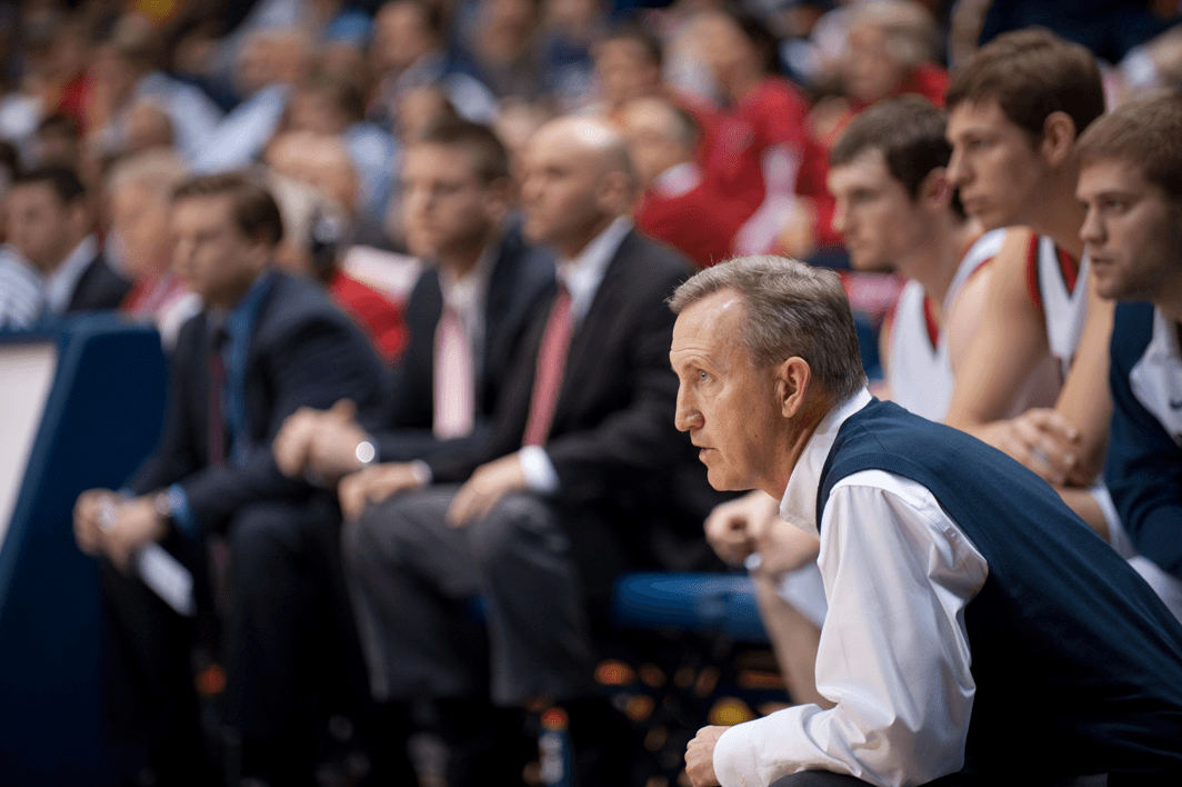 Men's Basketball Head Coach Rick Byrd observes from the sidelines