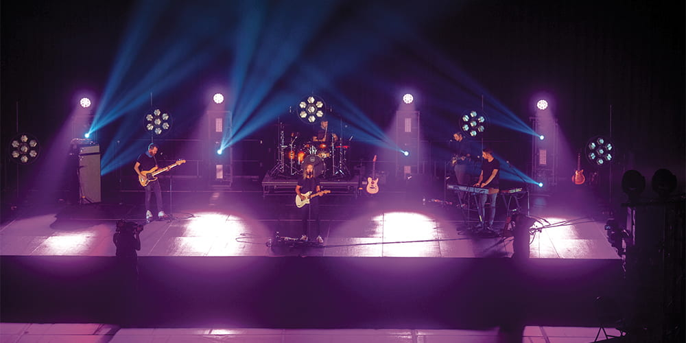 A photo of Moon Taxi performing on Stage