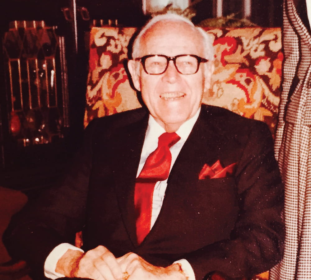 Jack C. Massey sitting in a chair