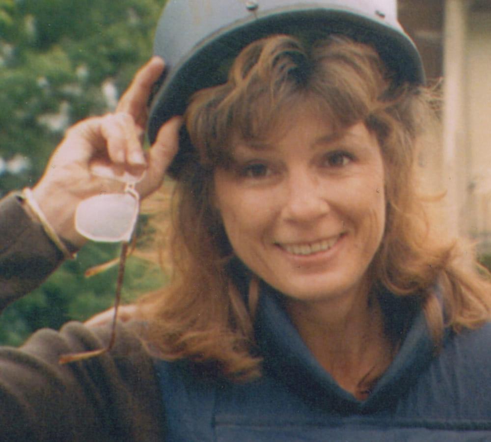 Carol Etherington wearing a military helmet and a flack jacket
