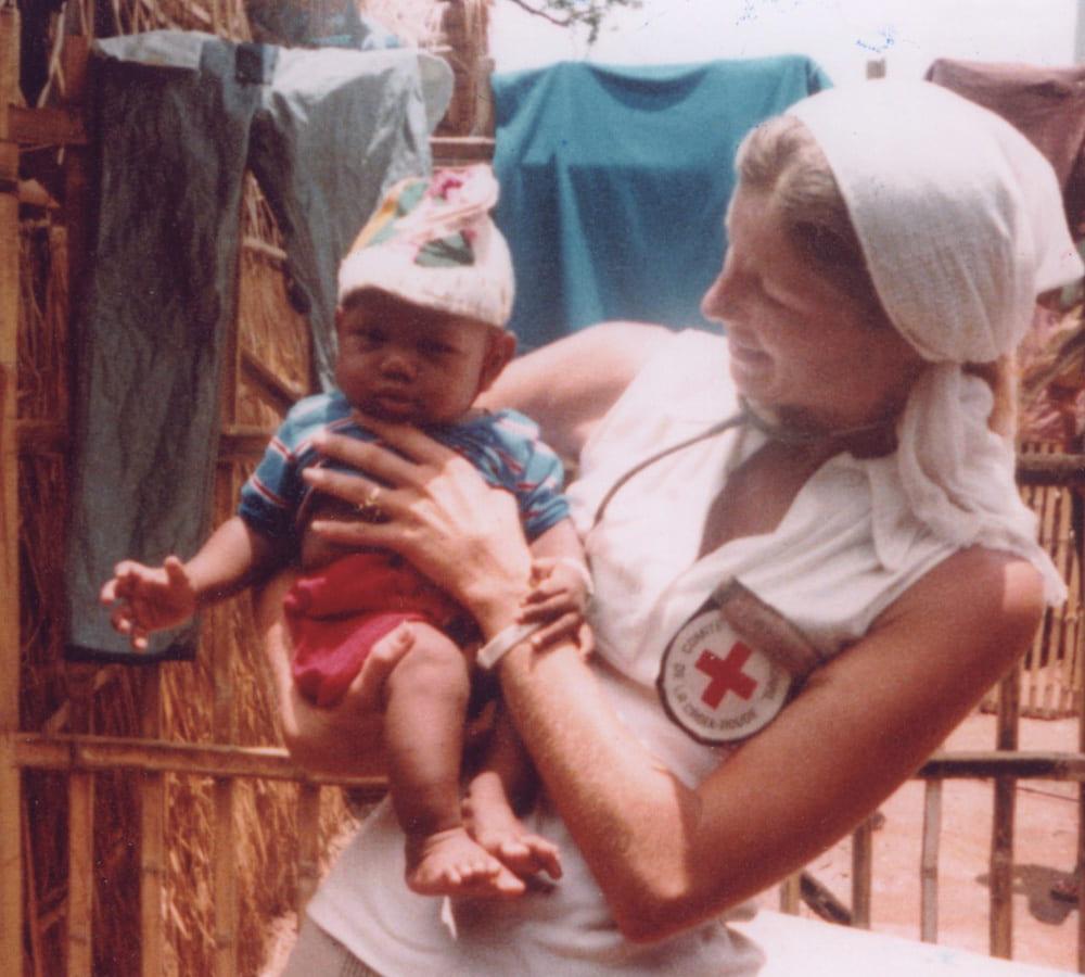 Carol Etherington holding a a baby