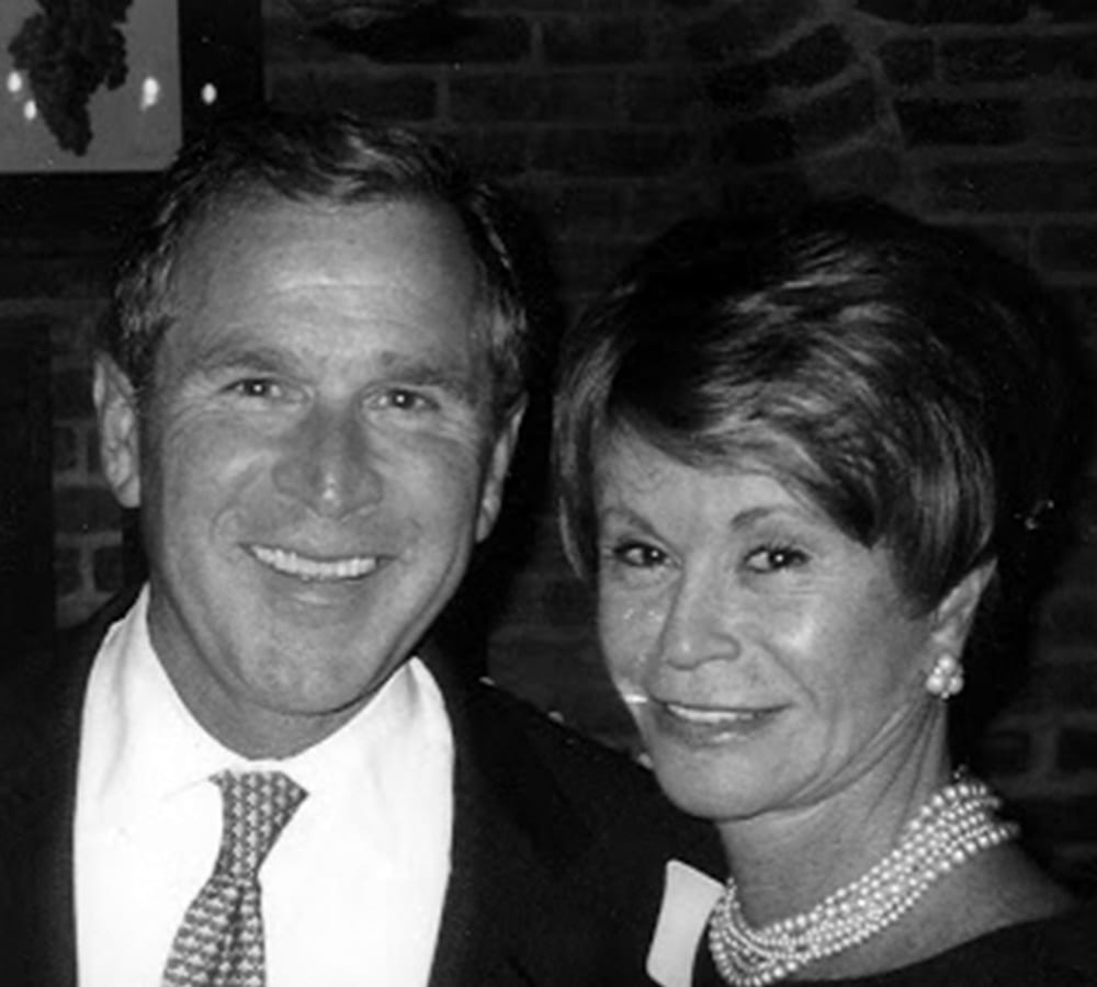 A photo of Colleen Conway Welch and President George W. Bush