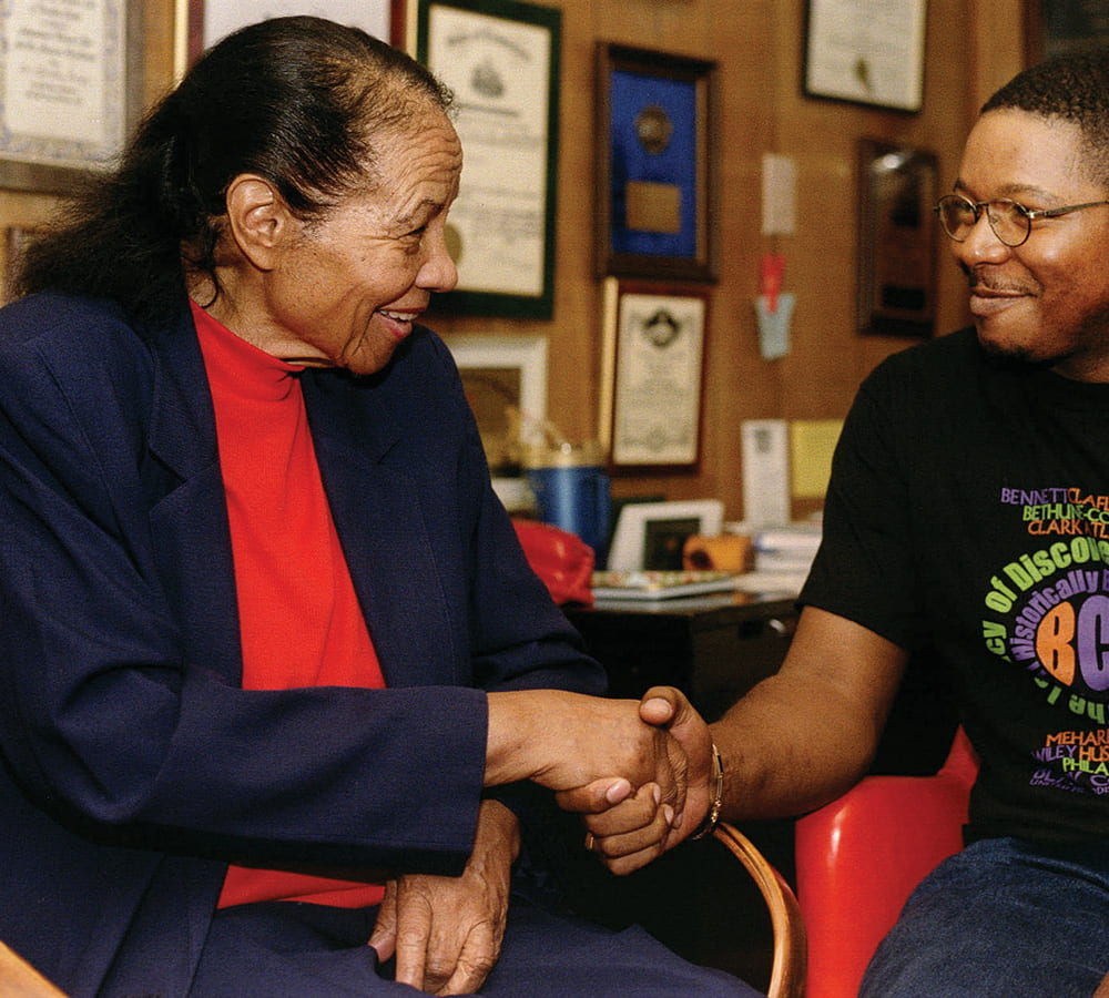 Dorothy Brown shakes the hand of a man with glasses