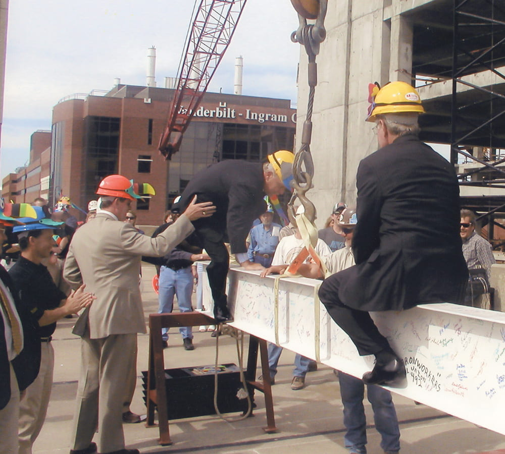 Harry Jacobson standing with colleagues at a construction site.