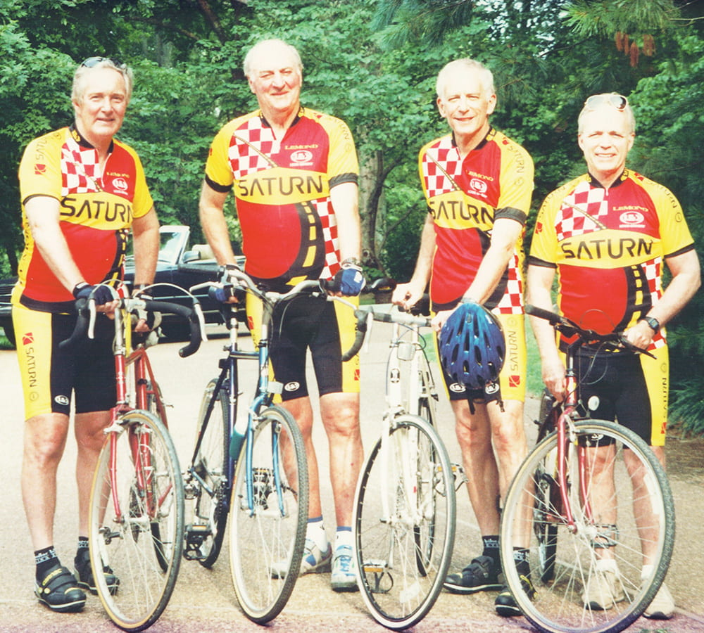 Joel Gordon posing with colleagues and their bicycles