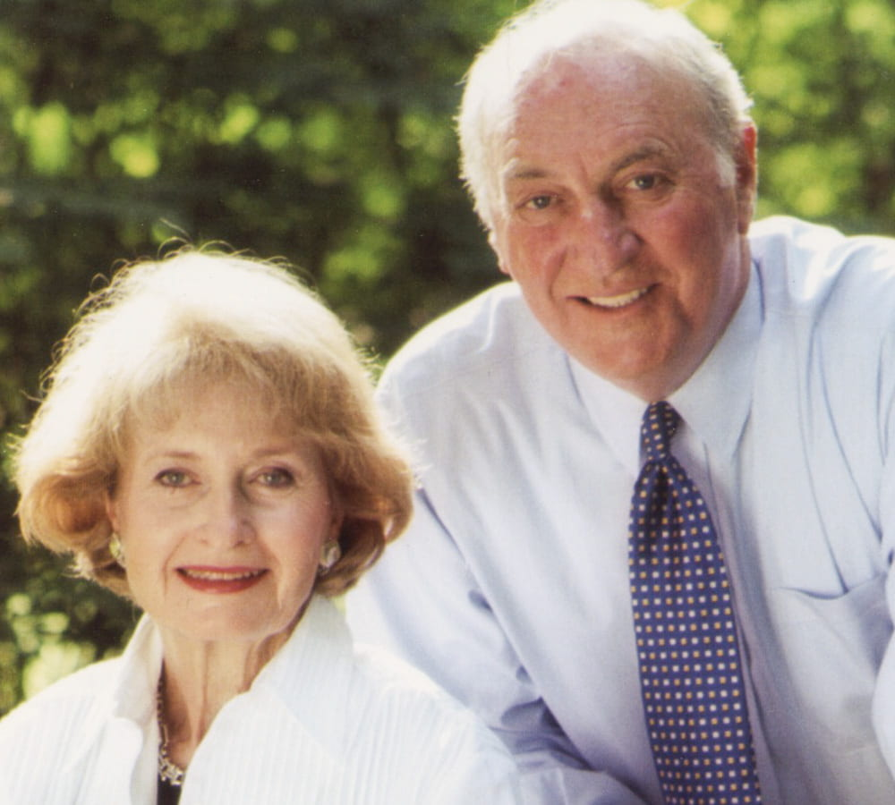 Joel Gordon posing in a photo with his wife