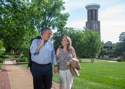 Dr. and Rev Jones walking on campus