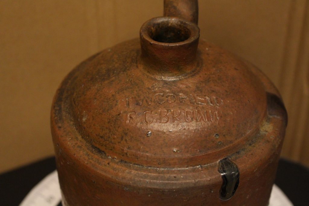 Whisky jug with stamp showing T.W. Cofield and E.C. Brown