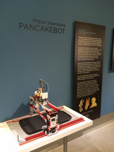 Pancakebot extrudes batter onto a hotplate for custom pancakes.