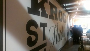 Krog Street Market sign artwork painted on a wall inside the market