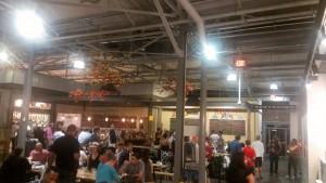 People eating and socializing inside Krog Street Market