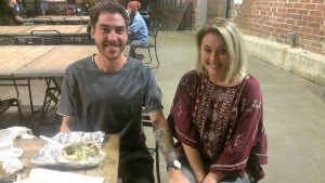 Curtis, Jenny, and their dog enjoying a meal outside of Krog Street Market