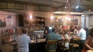 People drinking at a bar inside Krog Street Market