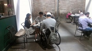 A man in a wheelchair eats at Krog Street Market