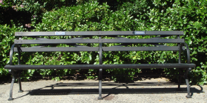Divided central park bench.