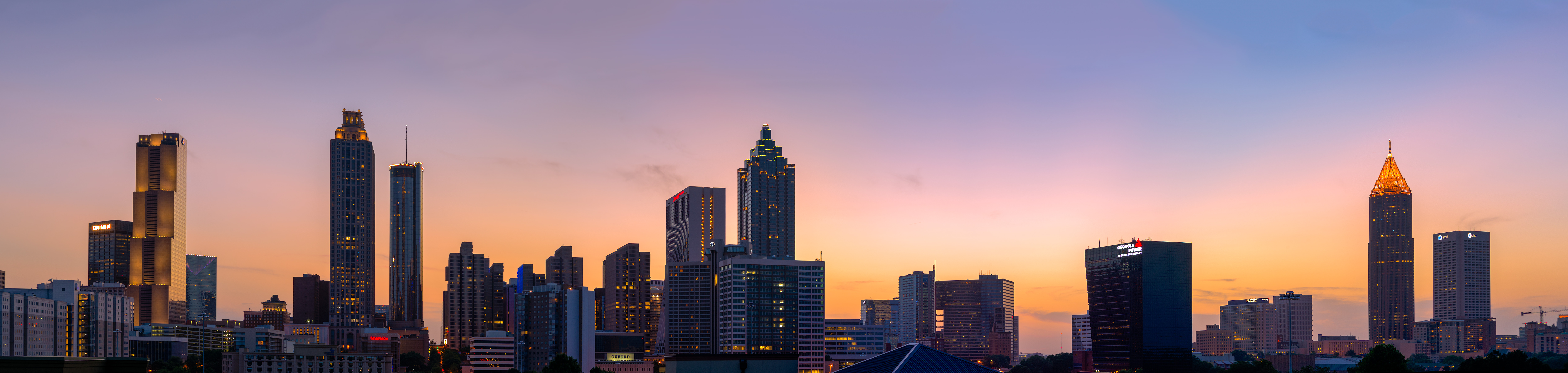 A picture of the Atlanta skyline at sunset.