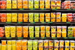 Fruits in plastic containers on a shelf