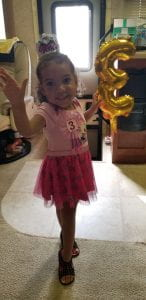 Cute Toddler waiving on her third birthday