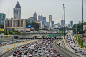 A depiction of Atlanta traffic with the skyline in the backdrop